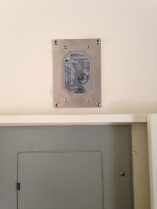 Flush Mounted Thor Systems TSz Surge Arrestor Installed on Flush Electrical Panel in Cabinet